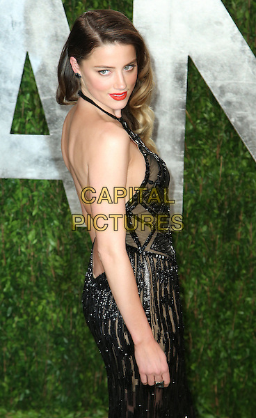 Amber Heard.2013 Vanity Fair Oscar Party following the 85th Academy Awards held at the Sunset Tower Hotel, West Hollywood, California, USA..February 24th, 2013.oscars half length black halterneck dress sequins sequined sheer side backless .CAP/ADM/SLP/DOW.©Dowling/StarlitePics/AdMedia/Capital Pictures