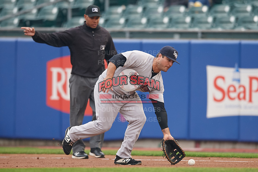 Scranton/Wilkes-Barre RailRiders first baseman Mike Ford (36) fields a ground ball in front of first base umpire Jeremie Rehak during an International League game against the Buffalo Bisons on June 5, 2019 at Sahlen Field in Buffalo, New York.  Scranton defeated Buffalo 3-0, the first game of a doubleheader.  (Mike Janes/Four Seam Images)