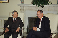 Washington DC., USA, September 28, 1990<br /> President  George H.W. Bush with Bulgarian President Zhelyu Mitev Zhelev during official photo opportunity in the Oval Office in front of the fireplace. Credit: Mark Reinstein/MediaPunch