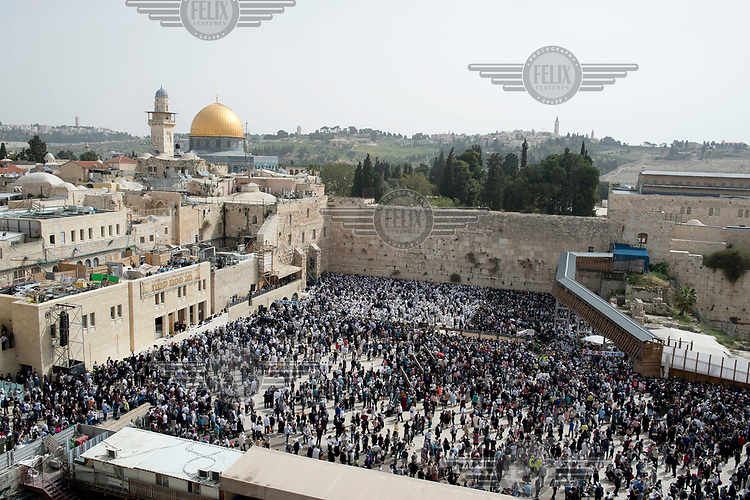 Jewish worshippers gather at the Western Wall where people come for a traditional 'Priestly Blessing' during the Passover (Pesach) holiday. In the background is the Al-Aqsa compound and the Dome of the Rock.