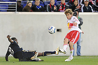Chris Albright (3) of the New York Red Bulls crosses the ball as Danny Mwanga (10) of the Philadelphia Union attempts a tackle. The New York Red Bulls defeated the Philadelphia Union 2-1 during a US Open Cup qualifier at Red Bull Arena in Harrison, NJ, on April 27, 2010.