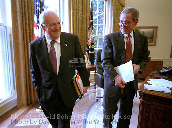 Vice President Cheney and President George W. Bush: share a joke in Oval. Attend Cabinet meeting. Cabinet Room. Released to Life October 2002. President Bush and Vice President Cheney talk in the Oval Office..Release to Living White House book  6/10/03..Released to NIGHTLINE 111203 and National Journal. .Released To:  Ron Kessler, 2-10-04 .Used in OVP 2002 Christmas Slide Show.WEB .WEST WING JUMBO .WEB.
