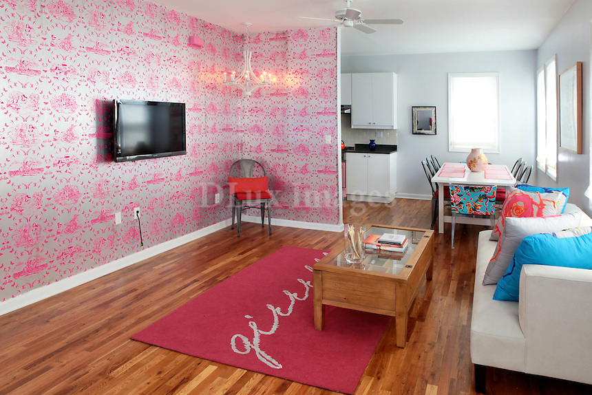 bright girly living room with pink wallpaper