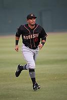 Eugene Helder (10) of the Modesto Nuts runs before a game against the Visalia Rawhide at Recreation Ballpark on June 10, 2019 in Visalia, California. (Larry Goren/Four Seam Images)
