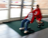 Sam Salem 12, (right) twin to Jake, pushes his brother  Joseph 8, twin to Sophia, across the cafeteria while waiting for Sam and Jake's match to begin in the Pennridge High School in Perkasie, Pa. The Salem children, 3 sets of twins, are from Russia. Sophia and twin Joseph were adopted at 11 months of age by Hythem and his wife Lisa. The other twins were adopted just 20 months ago. All children are thriving in school and socially. photo by jane therese