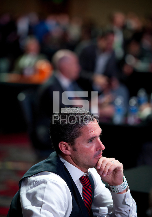 New England Revolution head coach Jay Heaps waits for the draft to start during the MLS SuperDraft at the Pennsylvania Convention Center in Philadelphia, PA, on January 16, 2014.