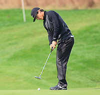 Thorbjorn Olesen (DEN) takes his putt on the 9th green during Sunday's Final Round of the 2014 BMW Masters held at Lake Malaren, Shanghai, China. 2nd November 2014.<br /> Picture: Eoin Clarke www.golffile.ie