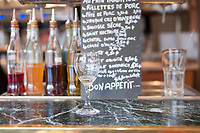 The counter of a Parisian bar with flavoured syrups and boiled eggs.