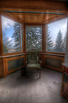 An old hotel in the Black Forest with abandoned room with view of trees