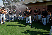 Batavia Muckdogs players, including Jonaiker Villalobos (center), celebrate after clinching the Pinckney Division Title during a NY-Penn League game against the Auburn Doubledays on September 2, 2019 at Falcon Park in Auburn, New York.  Batavia defeated Auburn 7-0 to clinch the Pinckney Division Title.  (Mike Janes/Four Seam Images)