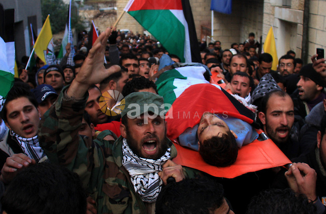 Palestinians carry the body of Khaldon Samodi ,25, during his funeral at al Yamoun Village near The West Bank City of Jenin on 08 January 2011. Israeli soldiers allegedly shot and killed Samodi at Hamra checkpoint east of Nablus in the northern West Bank, on 08 January 2011. Photo by Wagdi Eshtayah