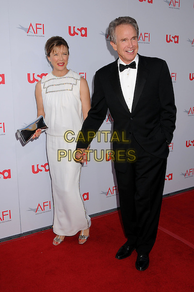 ANETTE BENNING & WARREN BEATTY.36th Annual AFI Life Achievement Award at the Kodak Theatre, Hollywood, California, USA,.12 June 2008 .full length white dress holding hands black tuxedo bow tie hoop earrings red lipstick fringe holding hands silver clutch bag shoes married husband wife.CAP/ADM/BP.©Byron Purvis/Admedia/Capital PIctures