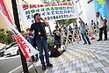 Protestors outside public hearing on Japan security legislation