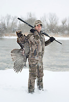 OutdoorLife Editor Andrew McKean (cq) stands in front of the Platte River with a wild turkey after a kill on a hunt in Nebraska, Saturday, December 3, 2011.