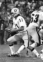 Oakland Raider quarterback David Humm, with Gene Upshaw...(1975 photo/Ron Riesterer)