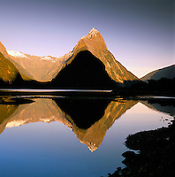 New Zealand, South Island, Milford Sound (Fjordland): View across Fjord to Mitre Peak at Sunrise | Neuseeland, Suedinsel, Milford Sound (Fjordland): Blick ueber den Fjord zum Mitre Peak bei Sonnenaufgang
