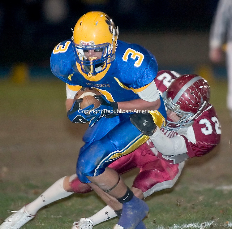 SEYMOUR, CT- 27 OCT 06- 102706JT05- <br /> <br /> Seymour's Pat Lesko gets tackled by Naugatuck's Richard Blue during Friday's game at Seymour.<br /> Josalee Thrift Republican-American