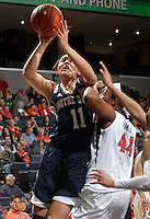 Notre Dame forward Natalie Achonwa (11) shoots nests to Virginia forward Sydney Umeri (44) during the first half of an NCAA basketball game Sunday Jan. 12, 2014 in Charlottesville, VA. (Photo/The Daily Progress/Andrew Shurtleff)