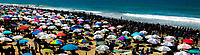 Huntington Beach, CA - Sunday August 06, 2017: A sea of Vans umbrellas during a World Surf League (WSL) Qualifying Series (QS) Championship Final heat in the 2017 Vans US Open of Surfing on the South side of the Huntington Beach pier.