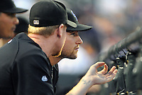 26 MAY 2010: Colorado Rockies catcher Chris Iannetta (right) talks in the dugout with starting pitcher Aaron Cook after being called up from a stint in AAA during a regular season Major League Baseball game between the Colorado Rockies and the Arizona Diamondbacks at Coors Field in Denver, Colorado. The Rockies led 3-0 after 5 innings. *****For Editorial Use Only*****