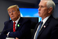 United States President Donald J. Trump listens as US Vice President Mike Pence speaks during a teleconference with governors at the Federal Emergency Management Agency headquarters, Thursday, March 19, 2020, in Washington, DC.<br /> Credit: Evan Vucci / Pool via CNP/AdMedia