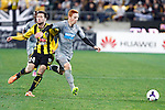 Newcastle United's Jack Colback, right, holds off Wellington Phoenix's Thomas Doyle, left, in the fourth match of the Football United Tour at Westpac Stadium, Wellington, New Zealand, Saturday, July 26, 2014. Credit: Dean Pemberton
