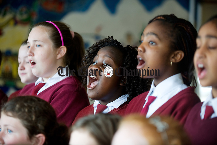 Charlene Makoni, and members of the award winning school choir of St Conaire's National School, Shannon. Photograph by John  Kelly.