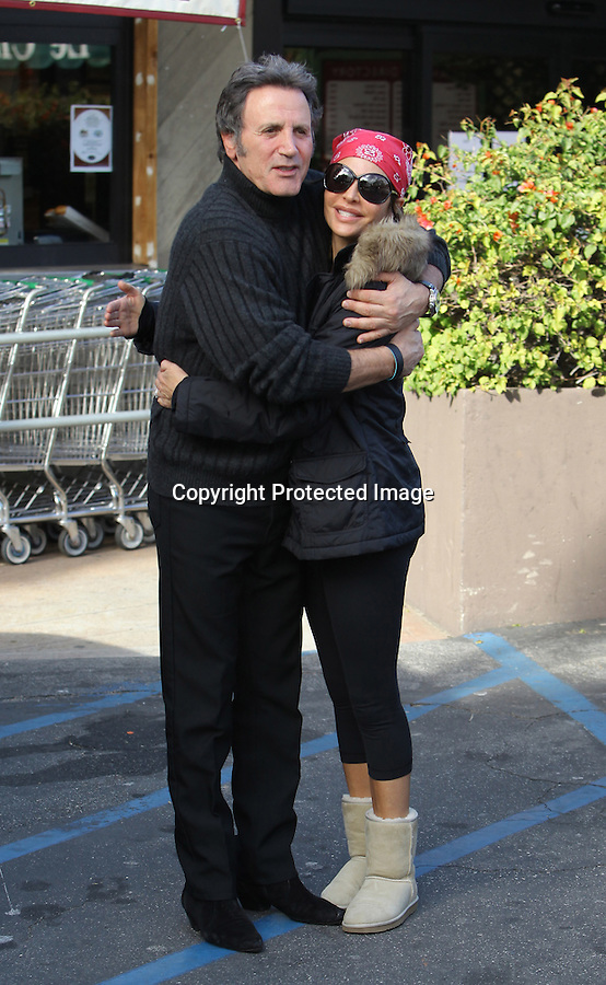 "January 6th 2011 ..Lisa Rinna shopping at the Beverly Glen shopping center in Los Angeles. Frank Stallone saw photographers taking pictures & yelled out at the photographers, ""who's that cunt your shooting!"" then he realized that he knew Lisa Rinna & gave her a big Italian hug.  Lisa was wearing UGG boots, tight spandex pants showing off her butt, a red bandana & big bug eye blue blocker sunglasses.  Looks like lisa still has big lips after her surgery. ..AbilityFilms@yahoo.com.805-427-3519.www.AbilityFilms.com."