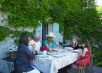 Jemima French and her family enjoy an al fresco lunch at her country house in Bergerac