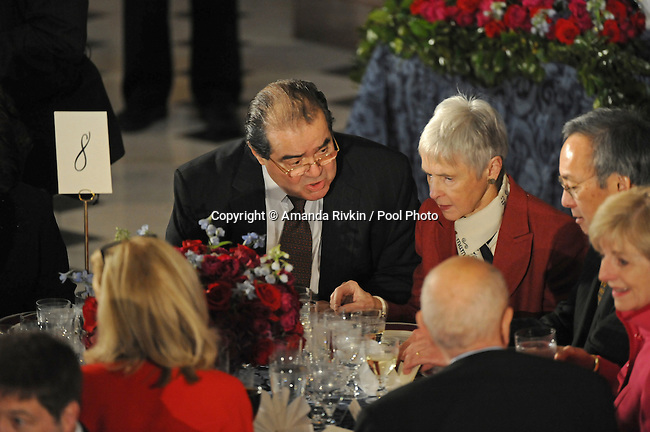 Supreme Court Justice Anthony Scalia talks with others at his table at the luncheon following Barack Obama's swearing in as the 44th President of the United States at Statuary Hall in the U.S. Capitol in Washington, DC on January 20, 2009.
