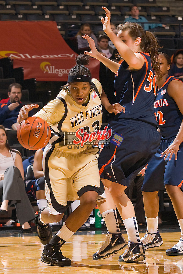Secily Ray #23 of the Wake Forest Demon Deacons drives the baseline past Chelsea Shine #50 of the Virginia Cavaliers at the LJVM Coliseum January 31, 2010 in Winston-Salem, North Carolina.  The Demon Deacons defeated the Cavaliers 64-57.  Photo by Brian Westerholt / Sports On Film