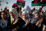 Misratan women sing the Libyan National Anthem at a celebration after the National Transitional Council officially declared liberation, Misrata, Libya, Oct. 23, 2011. The Council had promised to wait until the fall of Sirte to declare Libya free and begin forming a new government.