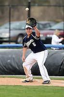 April 15,2010:  First Baseman Kevin Daniels (5) Genesee Community College (GCC) Cougars Men's Baseball Team gets a pick off attempt throw vs. Alfred State at Dwyer Stadium in Batavia, NY.  Photo Copyright Mike Janes Photography 2010