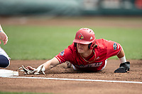 Louisville Cardinals shortstop Tyler Fitzgerald (2) dives back to first base during Game 7 of the NCAA College World Series against the Auburn Tigers on June 18, 2019 at TD Ameritrade Park in Omaha, Nebraska. Louisville defeated Auburn 5-3. (Andrew Woolley/Four Seam Images)