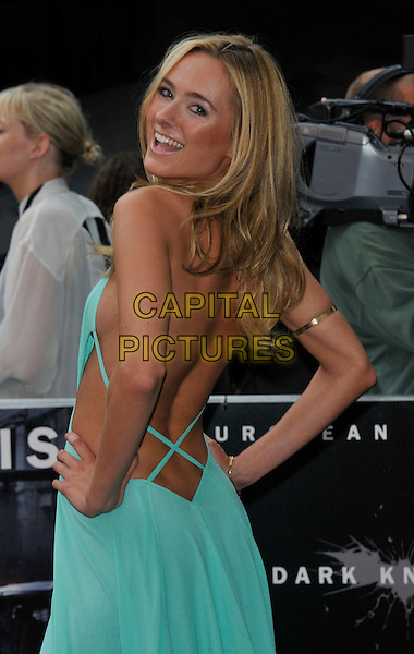 Kimberley Garner.'The Dark Knight Rises' European premiere at Odeon Leicester Square cinema, London, England..18th July 2012.half length blue dress backless hands on hips back behind rear looking over shoulder .CAP/WIZ.© Wizard/Capital Pictures.
