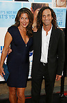 """HOLLYWOOD, CA. - September 21: Kenny G and wife Lyndie Benson arrive at the Los Angeles premiere of """"The Invention of Lying"""" at the Grauman's Chinese Theatr on September 21, 2009 in Hollywood, California."""