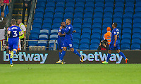 Kenneth Zohore of Cardiff City (10) celebrates scoring his side's first goal with goal provider Junior Hoilett during the Sky Bet Championship match between Cardiff City and Leeds United at the Cardiff City Stadium, Cardiff, Wales on 26 September 2017. Photo by Mark  Hawkins / PRiME Media Images.