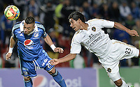 BOGOTÁ -COLOMBIA, 27-09-2014. Fernando Uribe (Izq) jugador de Millonarios salta por el balón con Carlos Rodriguez (Der) jugador de Fortaleza FC durante partido por la fecha 12 de la Liga Postobón II 2014 jugado en el estadio Nemesio Camacho el Campín de la ciudad de Bogotá./ Fernando Uribe (L) player of Millonarios jumps for the ball with Carlos Rodriguez (R) player of  Fortaleza FC during the match for the 12th date of the Postobon League II 2014 played at Nemesio Camacho El Campin stadium in Bogotá city. Photo: VizzorImage/ Gabriel Aponte / Staff