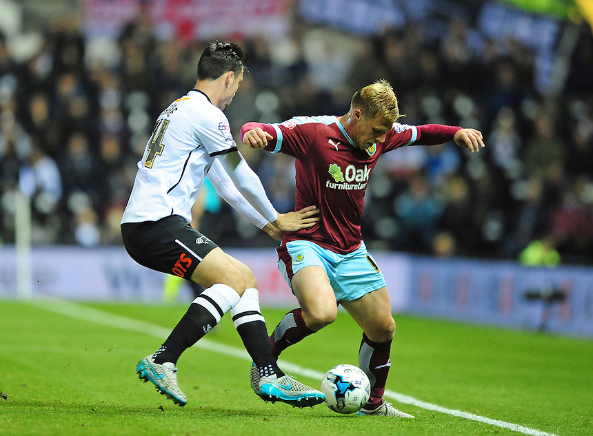 Burnley&rsquo;s Rouwen Hennings shields the ball from Derby County's George Thorne<br /> <br /> Photographer Chris Vaughan/CameraSport<br /> <br /> Football - The Football League Sky Bet Championship - Derby County v Burnley - Monday 21st September 2015 - iPro Stadium - Derby<br /> <br /> &copy; CameraSport - 43 Linden Ave. Countesthorpe. Leicester. England. LE8 5PG - Tel: +44 (0) 116 277 4147 - admin@camerasport.com - www.camerasport.com