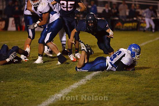 Pleasant Grove's Jeff Harris dives into the end zone for the go-ahead score, giving Pleasant Grove the eventual 12-7 win. Brighton vs. Pleasant Grove high school football Friday, October 9 2009 in Sandy.