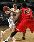 Reno Bighorns' Eric Devendorf passes around Idaho Stampede defenders during a basketball game Sunday, April 1, 2012 in Reno, Nev. Idaho won 108-99..Photo by Cathleen Allison