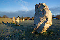 Great Britain, England, Wiltshire, Avebury: Prehistoric standing stone circle and village on frosty spring morning