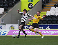 Kieran Doran being tackled by Liam Rowan in the St Mirren v Falkirk Clydesdale Bank Scottish Premier League Under 20 match played at St Mirren Park, Paisley on 30.4.13. ..