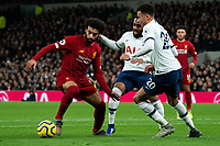 Liverpool's Mohamed Salah holds off the challenge from Tottenham's Dele Alli and Japhet Tanganga <br /> <br /> Photographer Stephanie Meek/CameraSport<br /> <br /> The Premier League - Tottenham Hotspur v Liverpool - Saturday 11th January 2020 - Tottenham Hotspur Stadium - London<br /> <br /> World Copyright © 2020 CameraSport. All rights reserved. 43 Linden Ave. Countesthorpe. Leicester. England. LE8 5PG - Tel: +44 (0) 116 277 4147 - admin@camerasport.com - www.camerasport.com