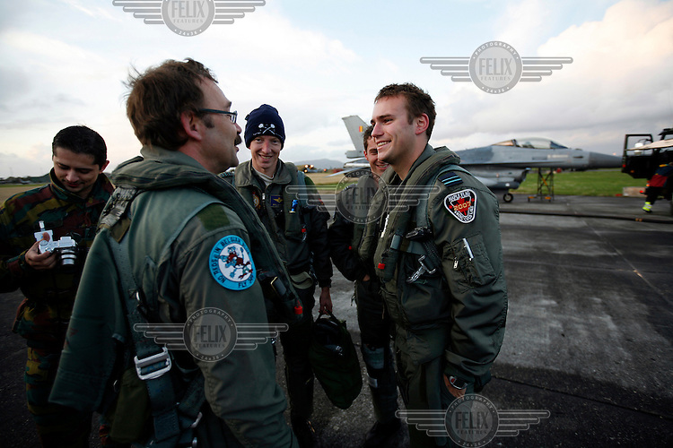 Pilots talk to happy passenger post flight in Lockheed Martin F-16 Fighting Falcon from Belgian Air Force 349 squadron. BOLD AVENGER 2007 (BAR 07), a NATO  air exercise at Ørland Main Air Station, Norway. BAR 07 involved air forces from 13 NATO member nations: Belgium, Canada, the Czech Republic, France, Germany, Greece, Norway, Poland, Romania, Spain, Turkey, the United Kingdom and the United States of America...The exercise was designed to provide training for units in tactical air operations, involving over 100 aircraft, including combat, tanker and airborne early warning aircraft and about 1,450 personnel.