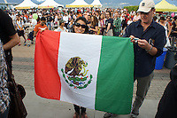 Woman holding up a Mexican flag at the Mexico Fest 2012 celebrations on Sept. 8, 2012 in Vancouver, British Columbia, Canada. These celebrations commemorated 202 years of Mexican Independence.