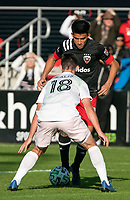WASHINGTON, DC - MARCH 07: Dylan Nealis #18 of Inter Miami defends against Yamil Asad #11 of DC United during a game between Inter Miami CF and D.C. United at Audi Field on March 07, 2020 in Washington, DC.