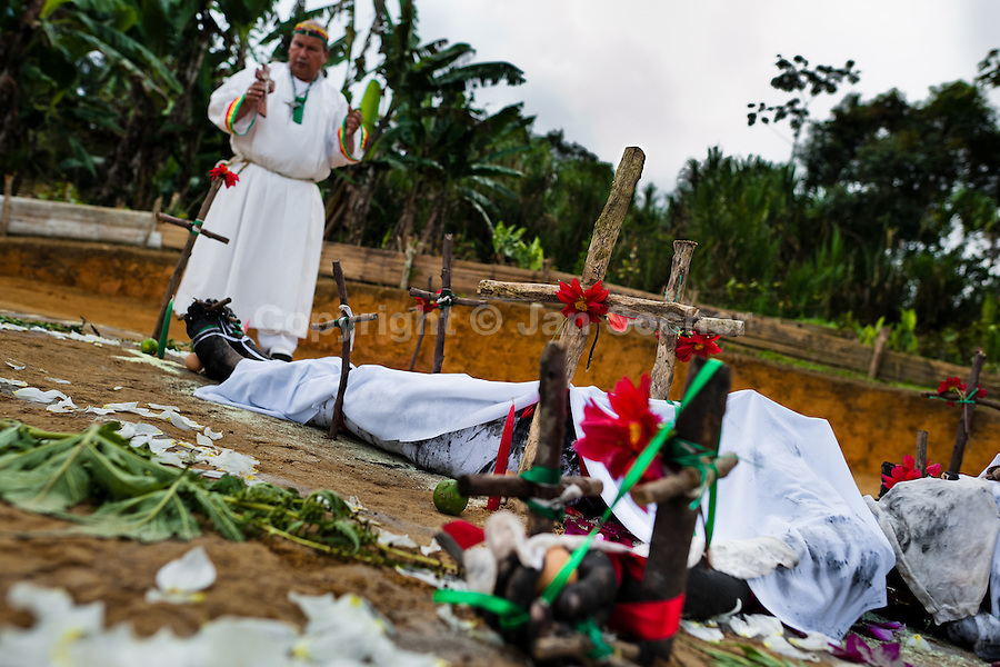 Hermes Cifuentes, a Colombian spiritual healer, performs a ritual of exorcism on Diana R., who claims to be possessed by spirits, in La Cumbre, Colombia, 28 May 2012. Exorcism is an ancient religious practice of evicting spirits, generally called demons or evil. Although the formal catholic rite of exorcism is rarely seen and must be only conducted by a designated priest, there are many pastors and preachers in Latin America performing exorcism ceremonies. The 52-year-old Brother Hermes, as the exorcist calls himself, claims to have been carrying out the healing rituals for more than 20 years. Using fire, dirt, candles, flowers, eggs and other natural-based items, in conjunction with Christian religous formulas, he attempts to drive the supposed evil spirit out of a victim's mind and body.