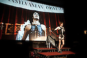 October 22, 2010. Raleigh, NC.. Frank sings his first song.. As the Rocky Horror Picture show nears its 35th anniversary, fans in the Triangle continue to go to the Rialto Theater in Raleigh every Friday to reenact the script, with some regulars still participating after 20 years.. .