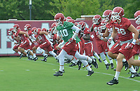 NWA Democrat-Gazette/MICHAEL WOODS &bull; @NWAMICHAELW<br /> University of Arkansas quarterback Brandon Allen (10) runs with his team as they get ready to start practice Thursday August 6, 2015 in Fayetteville.